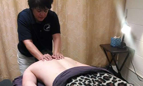 Student gives back massage.