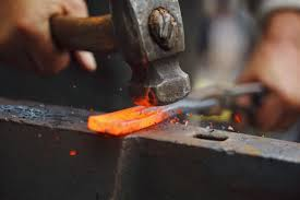 Hammer hitting hot steel