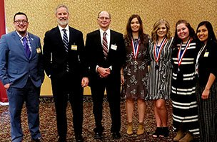 Phi Theta Kappa students with college representatives in Topeka.