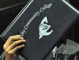 Diploma cover held by a graduate