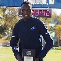 Wesley Banguria holding his national championship plaque
