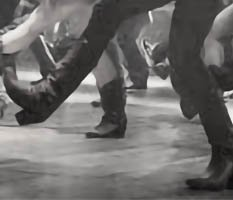 Feet of a group line dancing