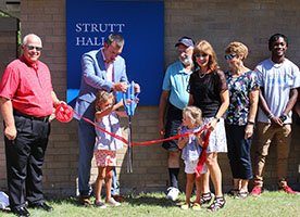 Cutting the ribbon to open Strutt Hall