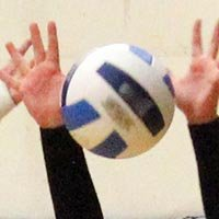 Hands blocking a volleyball